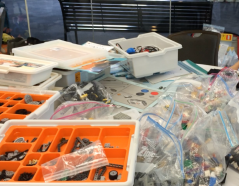 A maker table filled with supplies at the Constructing Modern Language conference in July 2014.