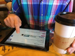 Mid-morning coffee with an iPad.