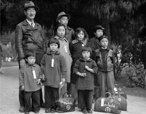Members of the Mochida family awaiting evacuation bus. By Dorothea Lange, Hayward, California, May 8, 1942 National Archives and Records Administration, Records of the War Relocation Authority